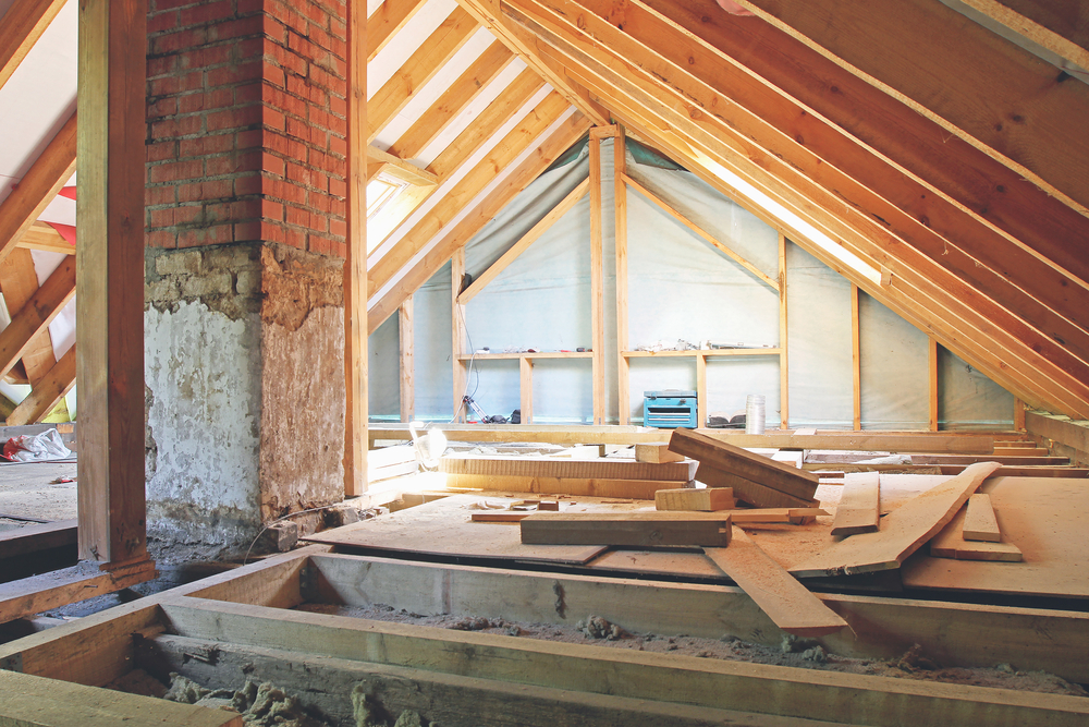 exposed beams and joists in an attic before loft conversion